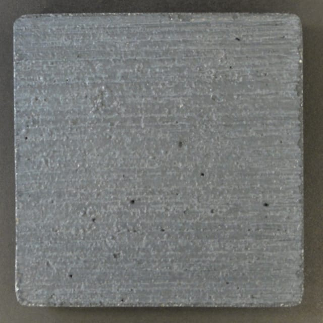 """This is a photo of an actual 3"""" x 3"""" concrete tile sample integrally colored with Davis Colors' Graphite (pigment # 8084) with a broomed finish. This video reproduction is just for ideas. Please finalize your color selection from our printed color card, hard tile samples or job site test."""
