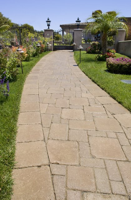 This walkway was paved with Orco Block's Pacific Cobble pavers and colored with Orco's own unique Sandstone (B15) color blend. Orco Block uses Davis Colors concrete pigments to create appealing color blends for their concrete pavers. To learn more about Orco's quality products visit them at www.orcopaverswalls.com/home.htm or call them at 800-473-6725.