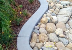 This winding concrete border was colored with Davis Colors' Pewter. The colored concrete was supplied by Superior Ready Mix (www.superiorrm.com).