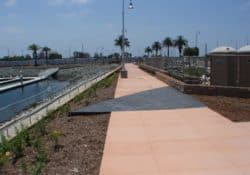 This is a photo of Pier 32 Marina located in National City near San Diego, CA. The concrete walkway was colored with Davis Colors' Spanish Gold (www.daviscolors.com). The concrete work was done by Mar Vista Construction (www.marvistaconstruction.com). The concrete was supplied by Superior Ready Mix (www.superiorrm.com, sales@superiorrm.com).
