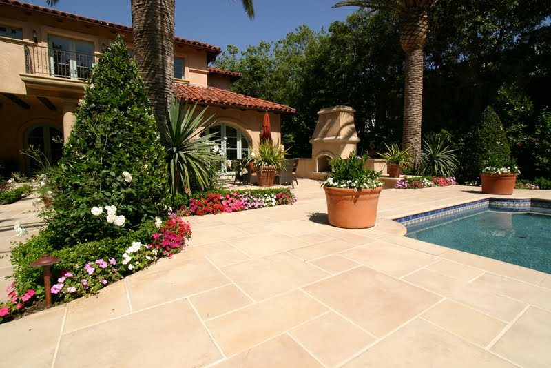 This decorative concrete stamped pool deck that was colored with Davis Colors San Diego Buff