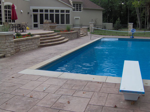This Ashlar Cut Slate stamped pool deck was integrally colored with Davis Colors Rustic Brown concrete color. The release agent was a Mocca color.