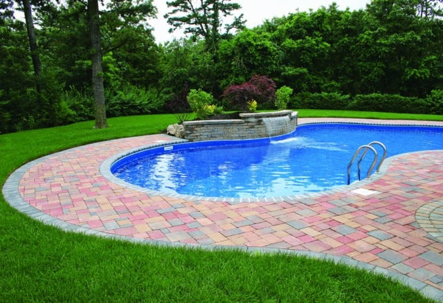 This pool deck is paved with Nicolocks Country pavers with their Autumn color blend. Nicolock uses Davis Colors concrete pigments to make their custom color blends. To learn more about Nicolocks products visit them at www.nicolock.com.