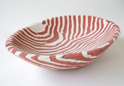 "This ""Red and White Lined Concrete Basin"" (16"" x 11.5"" x 3.5"") was made by Deborah Brackenbury through a unique process of layering hand-rolled and hand-cut colors of concrete (Davis Colors) in molds and wet-carving the green concrete. To learn more about Deborah Brackenbury's products go to http://impurevessels.com/home.html or call 405-414-8662."