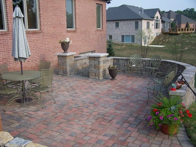 Concrete Block: Wilson Concrete products Country Manor with a Cedar color blend. The concrete pavers are Wilson Concrete Products Cobblesone Pavers with their custom New England color blend.