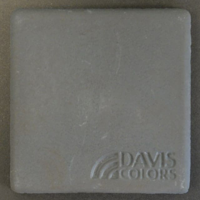 Sample tile colored with Davis Colors Jet Black Carbon concrete pigment