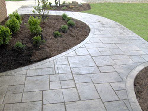 """This Ashlar Cut Slate stamped sidewalk was integrally colored with Davis Colors' Pebble concrete color. The release agent was a Desert Tan color. The 6"""" border has a slate stone texture. The concrete work was done by Butch Bando Concrete, Inc. located in Galena, Ohio. You can reach Butch Bando Concrete, Inc. by visiting their website at www.butchbandoconcrete.com or by calling them at 740-548-7322. These photos were provide by Butch Bando Concrete, Inc. and are being used with their permission."""