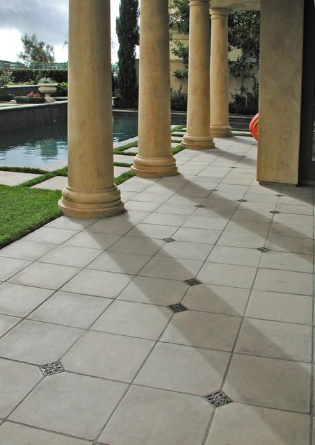 The Concrete tiles are colored with Davis Colors' pigments and made by CAL-GA-CRETE Industries Inc. To learn more about CAL-GA-CRETE'S concrete tile products visit them at www.calgacrete.com or call them at 310-639-8960.