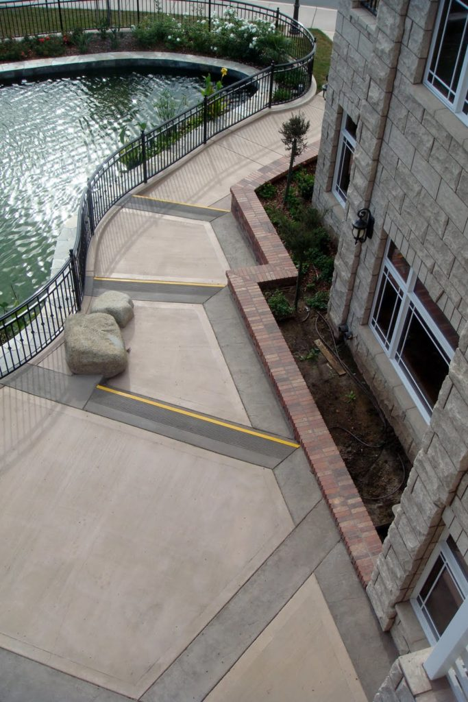 This walkway was integrally colored with Davis Colors' Padre Brown with a Walnut colored release agent and Davis Colors' Meadowbrook Brown (custom color). The colored concrete was supplied by Superior Ready Mix (www.superiorrm.com).