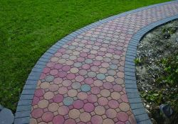 Photos of outdoor walkways created using Davis Colors concrete pigments and pavers