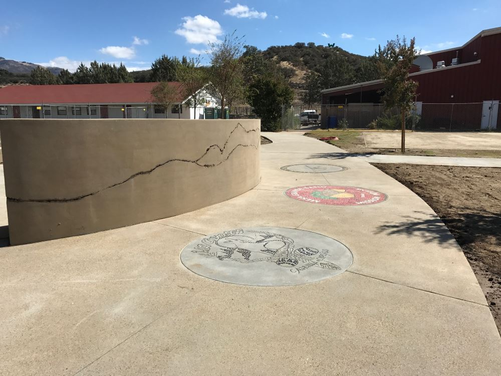 "We are proud to have donated concrete pigment to this project to create an outdoor community space for the <a href=""http://www.warnerusd.net/"" rel=""noopener"" target=""_blank"">Warner Unified School District</a> in Warner Springs, CA. This amazing concrete work was done by the talented team at <a href=""https://www.tbpenick.com/"" rel=""noopener"" target=""_blank"">T.B. Penick and Sons</a>. The concrete was provided and poured by the great team at <a href=""https://www.superiorrm.com/"" rel=""noopener"" target=""_blank"">Superior Ready Mix</a>."